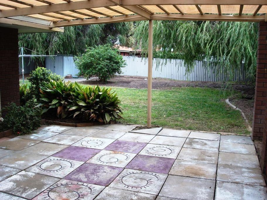 Huge back yard with playset, table and chairs and BBQ