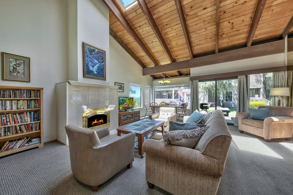 Cozy up by the fireplace and watch the HDTV in this spanning living area