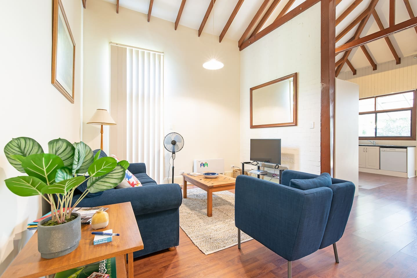 Spacious living space with smartTV and plenty of seating options for 3 guests.