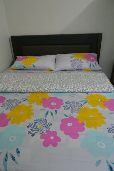 queen size bed with quality linens