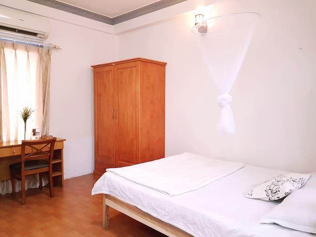Cozy room with tiny balcony