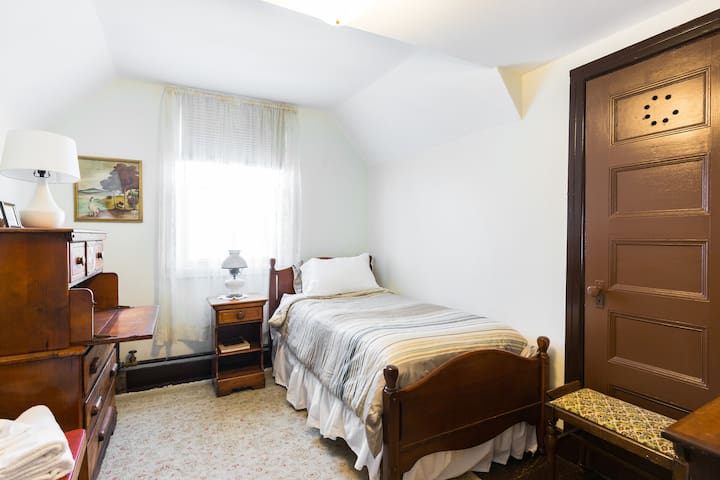 This is Room 5 - your private room for one.  In the summer an air conditioner in the window will keep you cool.