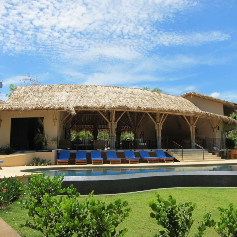 Enjoy time lounging at the pool of our Beach Club.