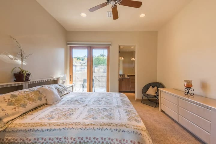 On the left side is King Suite with a brand new california king bed with laquered headboard, matching nightstands and matching 6 drawer dresser