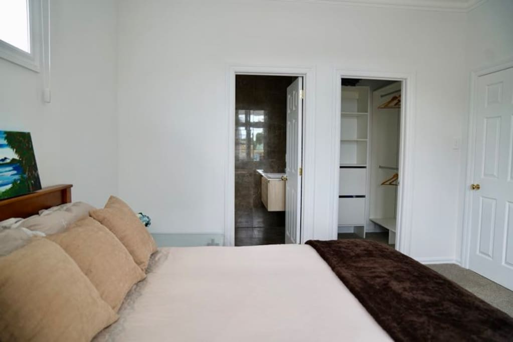 The bedroom is complemented with a walk in wardrobe and a private shower, toilet and vanity mirror