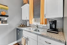 Kitchen: Cabinets contain a fire-extinguisher, hand-mixer, and much more
