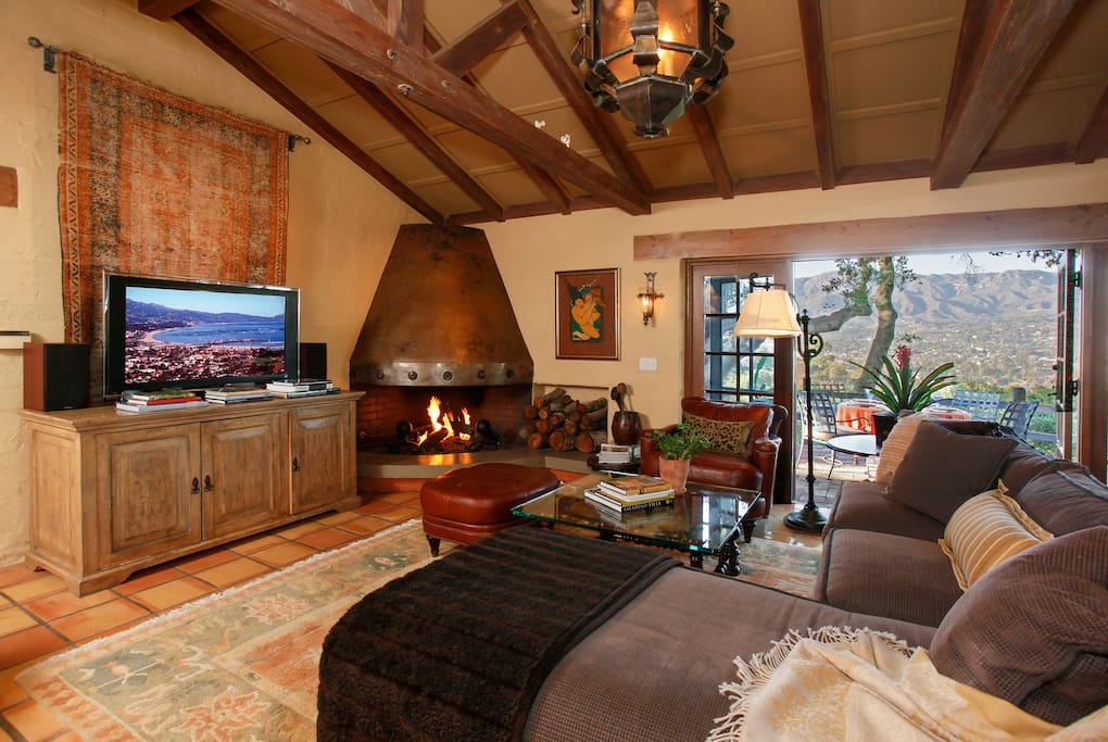 The grand living space features vaulted ceilings, tile floors, and a gas fireplace.