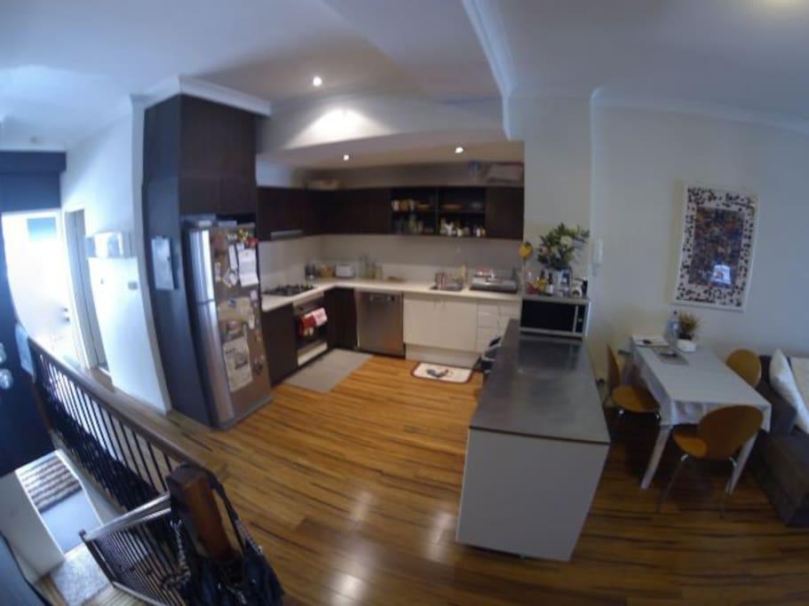 Large kitchen with dishwasher, oven, stove and large fridge