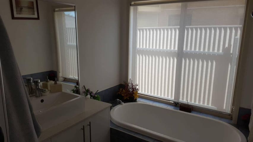 Bathroom with glass-door shower, bath and basin