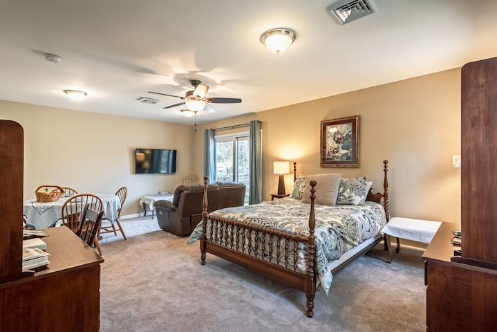 A clean roomy suite with a great bed.