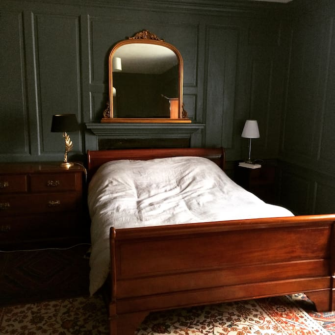 luxurious Georgian panelled bedroom, with king size bed.