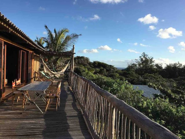Spacious decking overlooking lush vegetation and the ocean