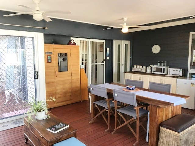 The spacious sunroom has lots of room to relax Large table,  Sauna, and leads out onto a spacious balcony  Tea and coffee making Facilities with toaster refrigerator and microwave.