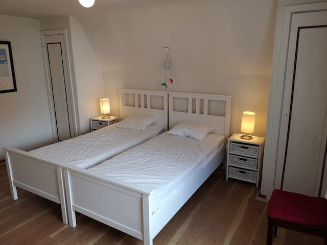 Bedroom 1 with two single beds