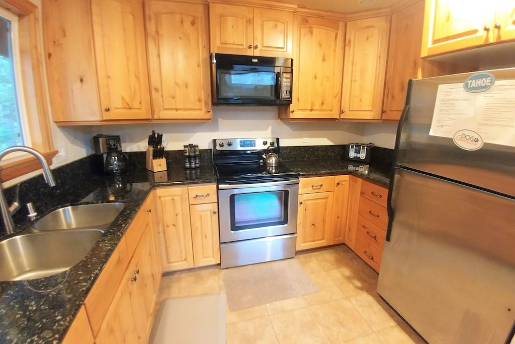 Remodeled Kitchen with granite counter tops, stainless appliances and beautiful custom wood cabinets.