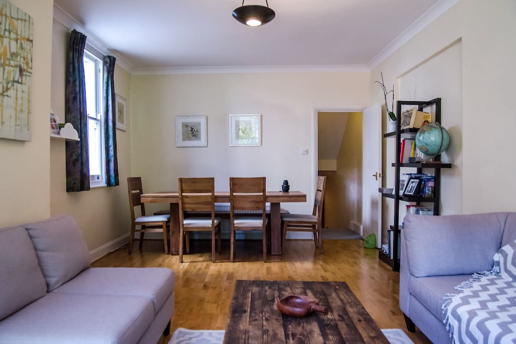 Our spacious and airy living room - includes a dining table for 8 people made from wood.