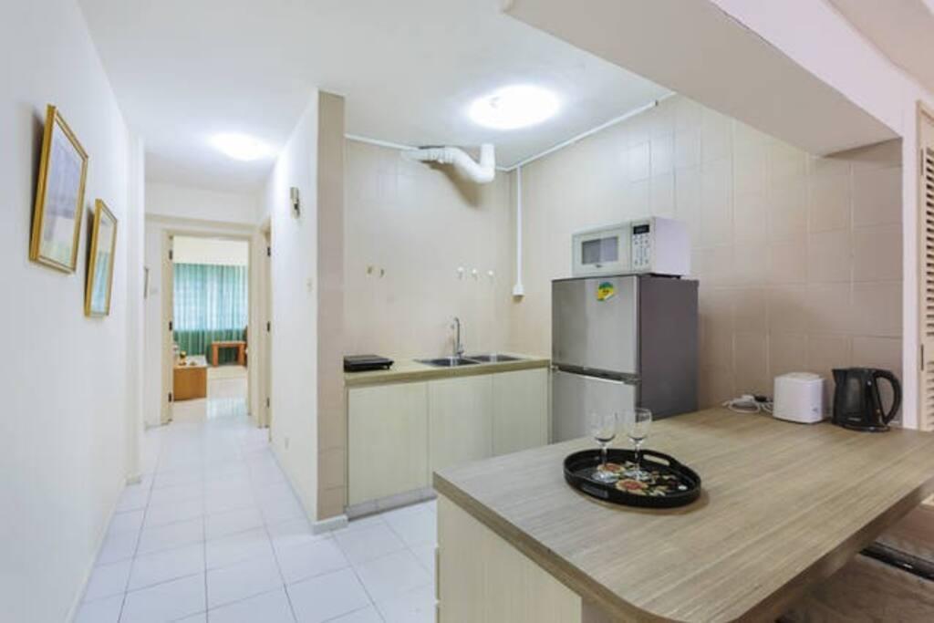 kitchen area with corridor towards bedroom