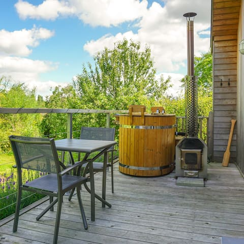 The private deck is your space to relax and enjoy the hot tub and views into the garden and hills beyond.