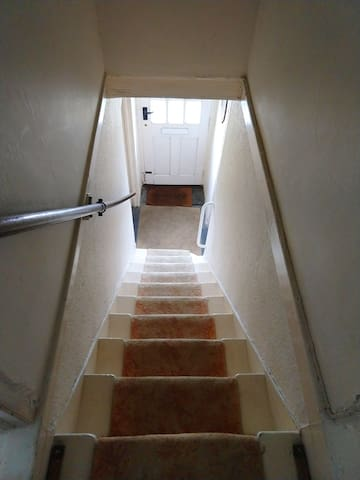 Slightly steep stairs with handrail