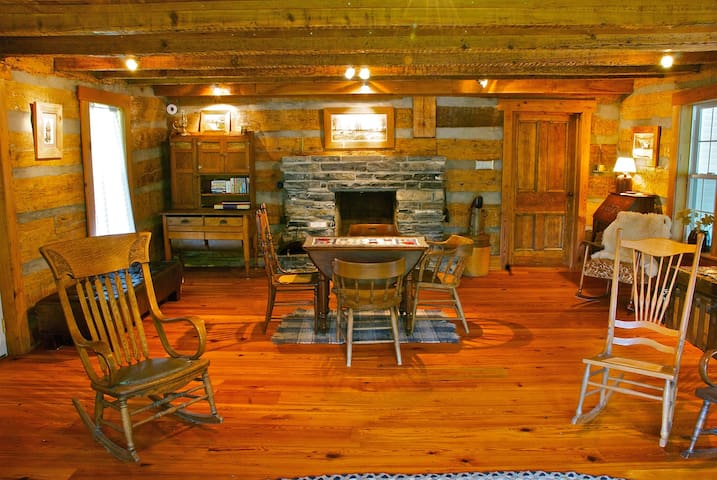 Log-cabin great room with stone fireplace