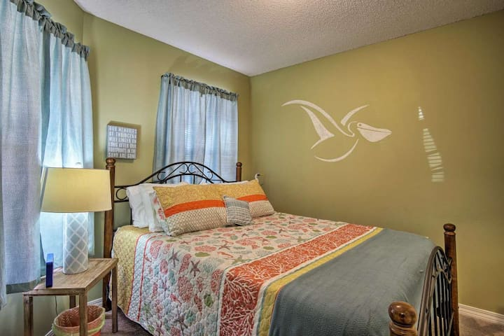 A third bedroom has a queen bed on a beautiful iron frame.  This room has darkening drapes for those who need a little less light coming in.