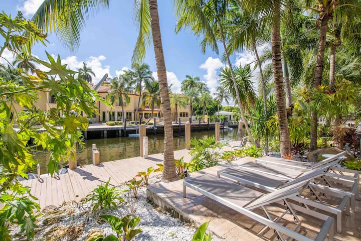 The expansive waterfront sundeck and dock overlooks the waters that lead to the Intracoastal.