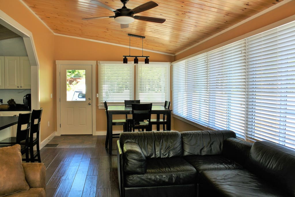 The living and dining area is open concept, features maple hardwood flooring and plenty of room for family togetherness.
