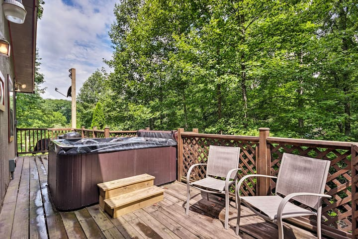 Look forward to unwinding on the deck, complete with a hot tub and forest views.