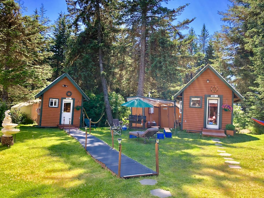 10x14 cabins. Cabin #1 (left) Cabin #2 (right), shared fire pit, outhouse and outdoor shower. Quiet after 10pm please.