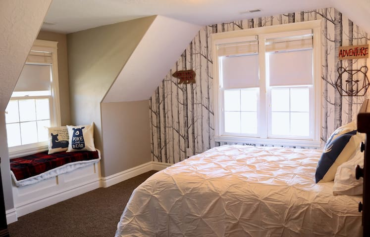 Dormer Windows and a sunny windowseat are part of the Forest themed room.  Watch out for wildlife!