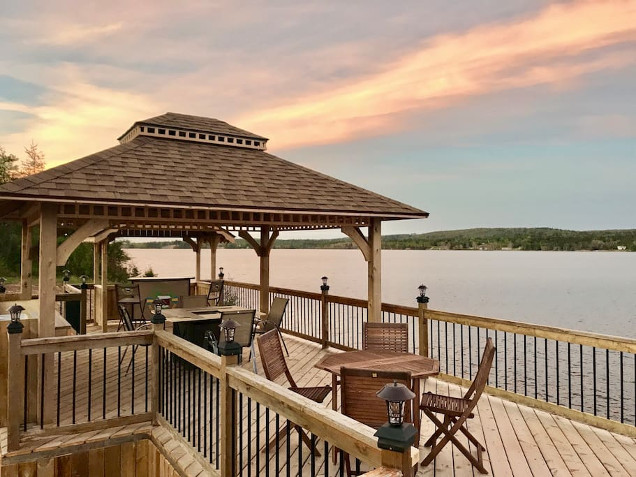 Waterfront deck with bar and seating