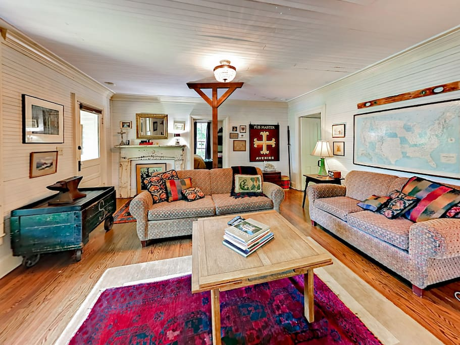 The living room offers plenty of seating on 2 sofas.