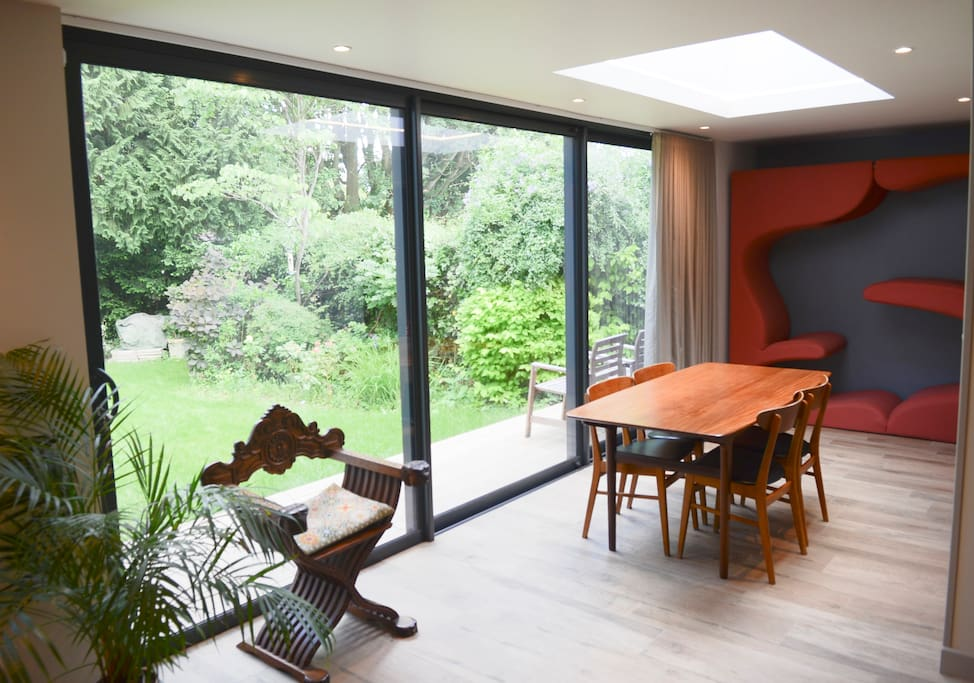 Sliding doors opening into garden for al fresco dining