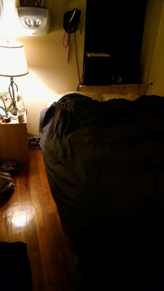 Bedroom at night w/blind down