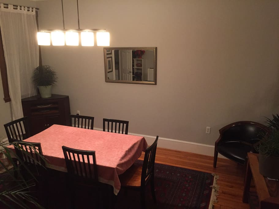 Main level - Dining room with table and six chairs.  Three more chairs can be pulled up for more seating.