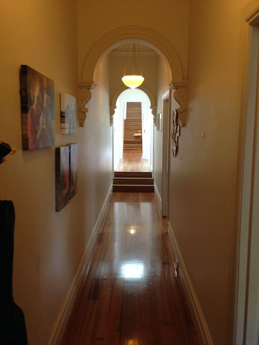 Gorgeous original hall way leading to new renovation.