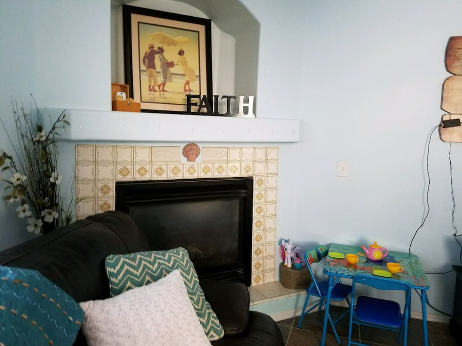 Living room fireplace and kid area