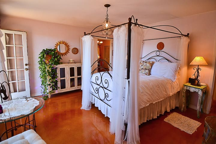 Romantic Lavender Suite bedroom with lake & pool view.