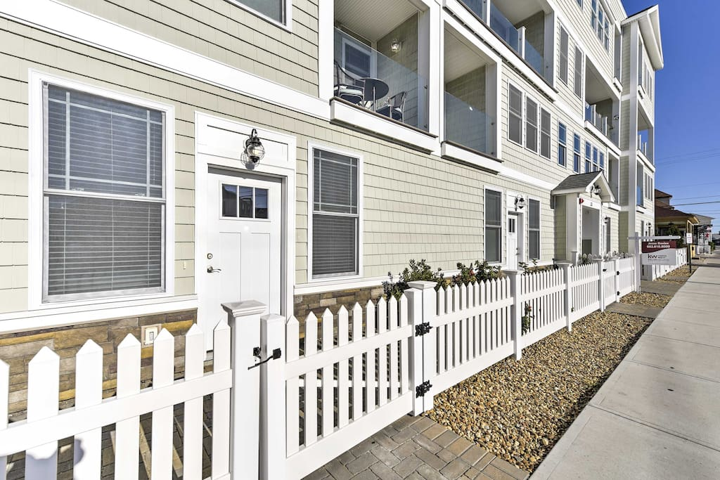 A quaint white picket fence welcomes you to your getaway.