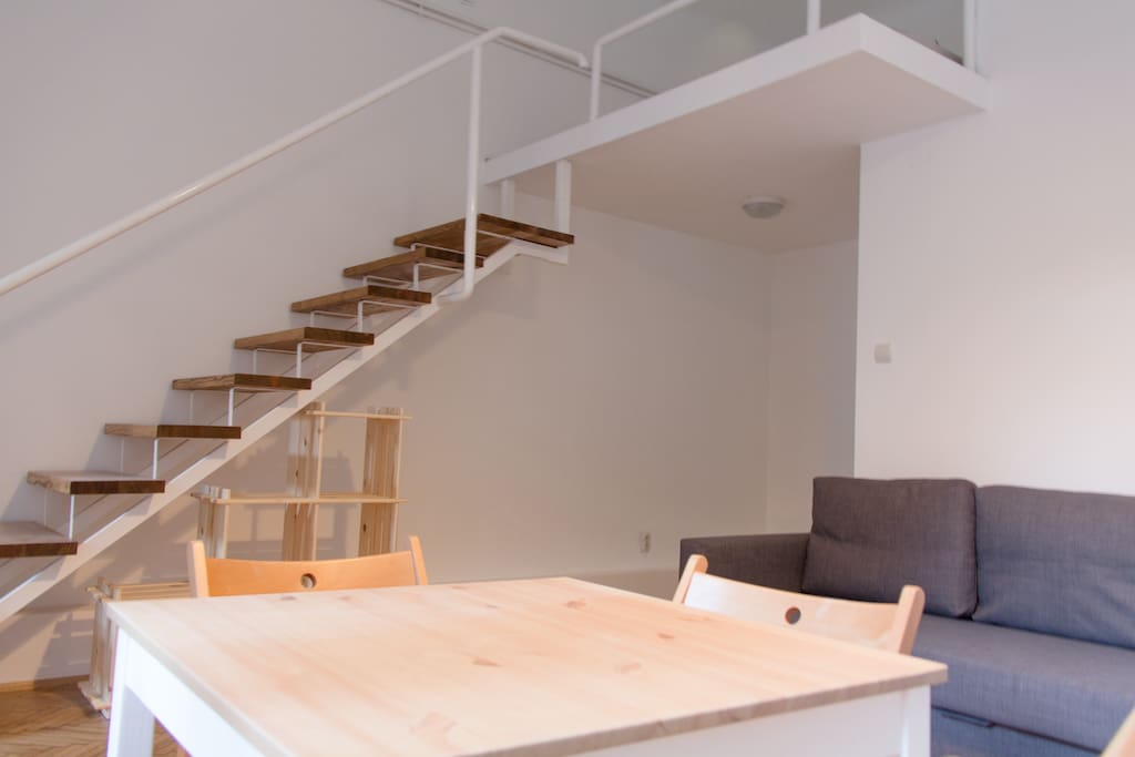 Lounge area and mezzanine-level stairs