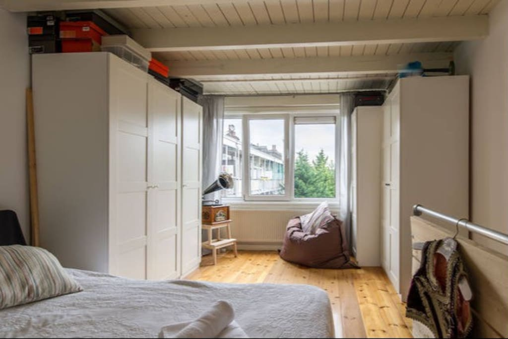 Bedroom upstairs with the Roof terrace view