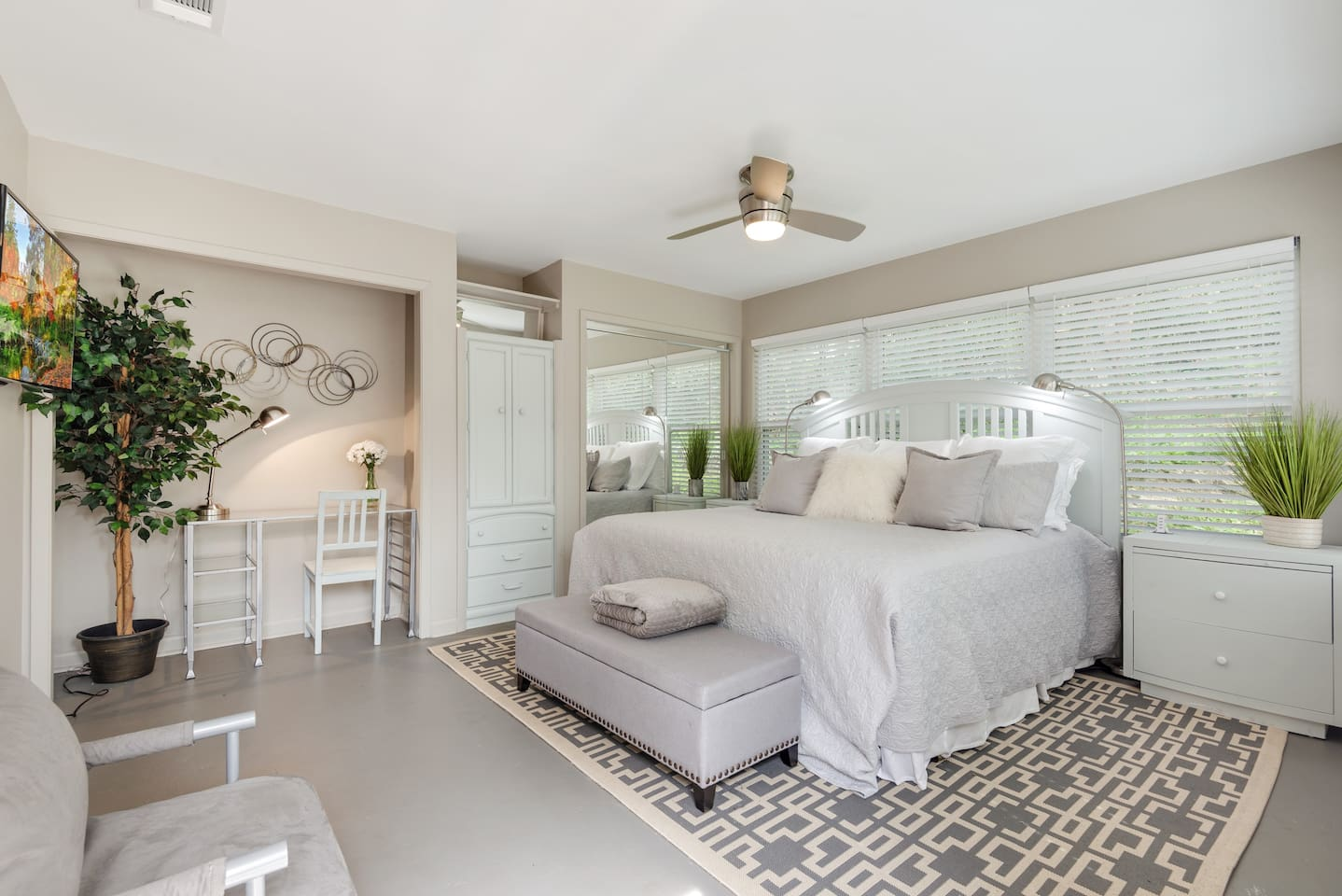 Chic and luxurious master bedroom that overlook an outdoor garden and patio.