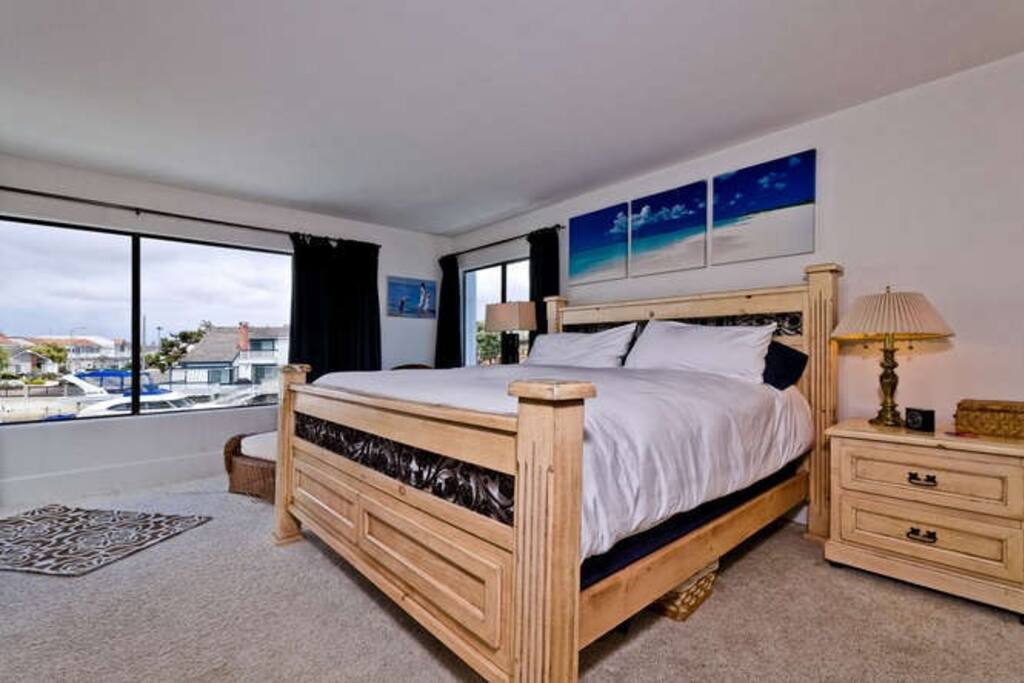 Comfy king size bed with view of the harbor