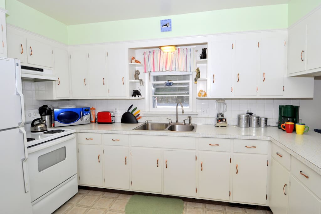 The fully equipped kitchen is ready to handle your cooking needs.
