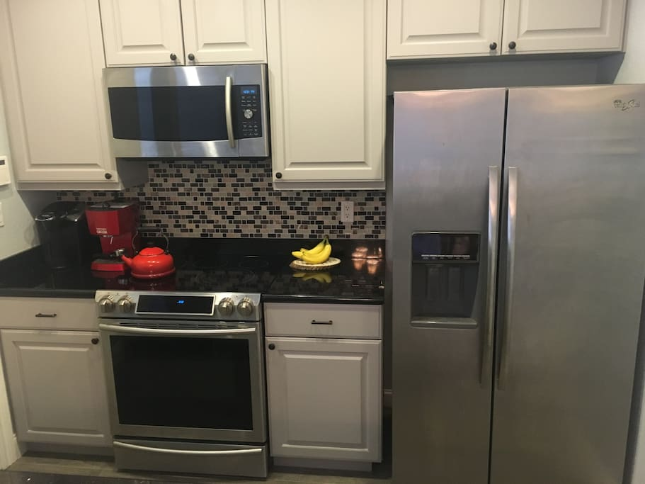 Updated kitchen with a Keurig, an espresso machine, and top of the line appliances