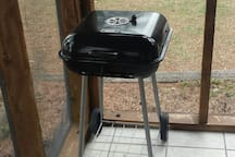 Charcoal BBQ grill with basic utensils....charcoal not included