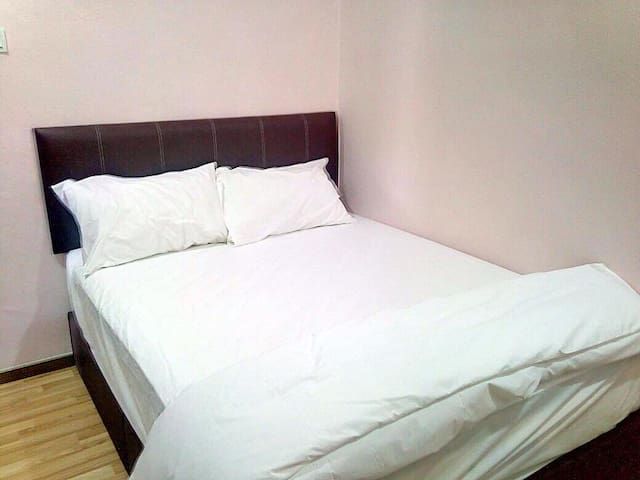 Double bed room with shared bathroom
