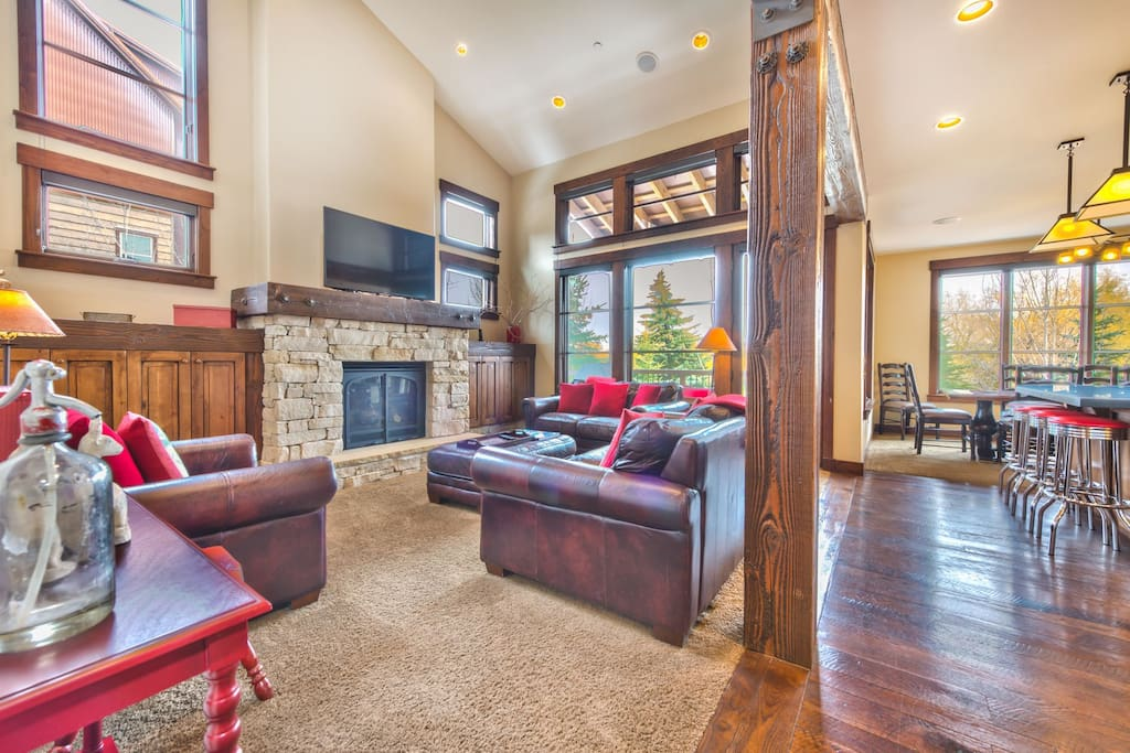 """Main level living room with fireplace, 55"""" TV, and cozy seating"""