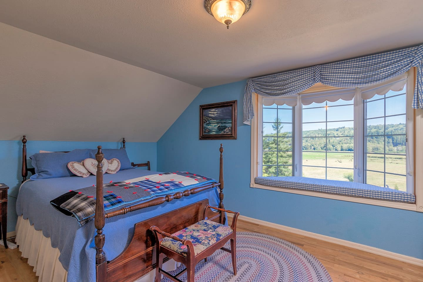 The spacious Valley View Room features a queen bed and is part of a two-bedroom suite with a private bath