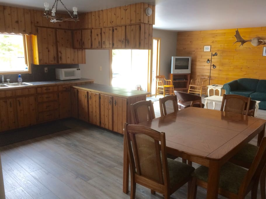 Very bright and spacious open concept kitchen, dining and living space opening to the back deck and yard overlooking the lake.